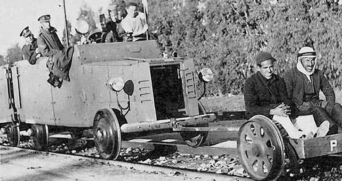 A British armored railroad wagon behind a railcar on which two Arab hostages are seated, 1936-1939 Arab Revolt
